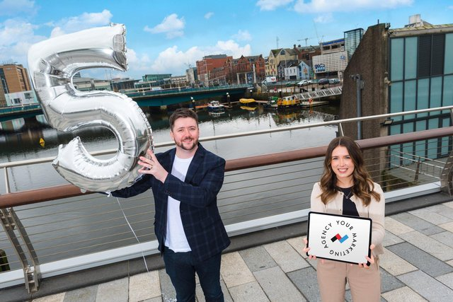 James Scullion, founder and director of Rapid Agency is pictured with Tori Rea, Graphic Designer for the growing business