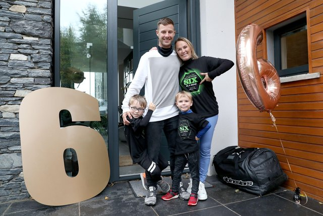World Superbike champion, Jonathan Rea, is welcomed back  home to a huge welcome from his sons Jake and Tyler and wife Tatia after winning the title for the sixth time in Estoril, Portugal in 2020.  Picture: Steven Davison.