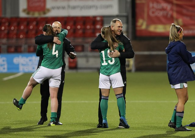 Northern Ireland women's team manager Kenny Shiels (centre) celebrates on Tuesday evening.