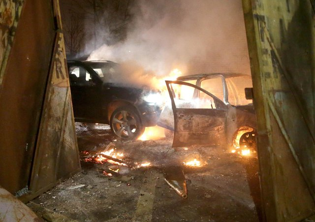 PACEMAKER, BELFAST, 7/4/2021: The burning remains of two cars which loyalist rioters used to ram the security gate at the Lanark Way interface as they fought with nationalist riotersPICTURE BY STEPHEN DAVISON