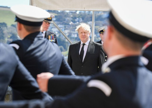 Boris Johnson at passing-out parade, Britannia Royal Naval College, Dartmouth yesterday. Only he can get damages for Libya-IRA victims