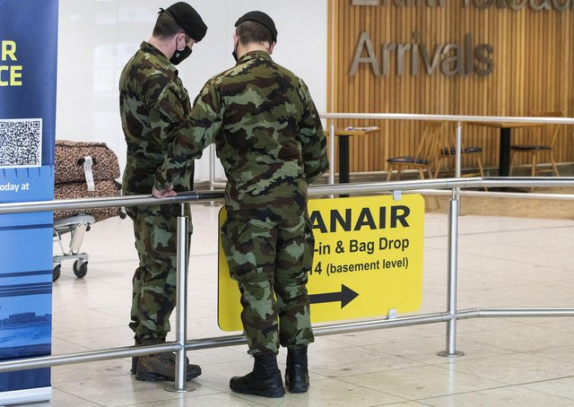 Members of the defence forces in Terminal 1 arrivals hall at Dublin Airport as the StateÕs mandatory quarantine system was extended on Thursday to include the US, Belgium, France and Italy. Picture date: Thursday April 15, 2021. See PA story IRISH Coronavirus. PA Photo. Photo credit should read: Brian Lawless/PA Wire