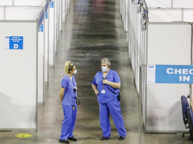 Nurses pictured inside the SSE Arena, Belfast, which is being used by the Department of Health as a mass vaccination centre.