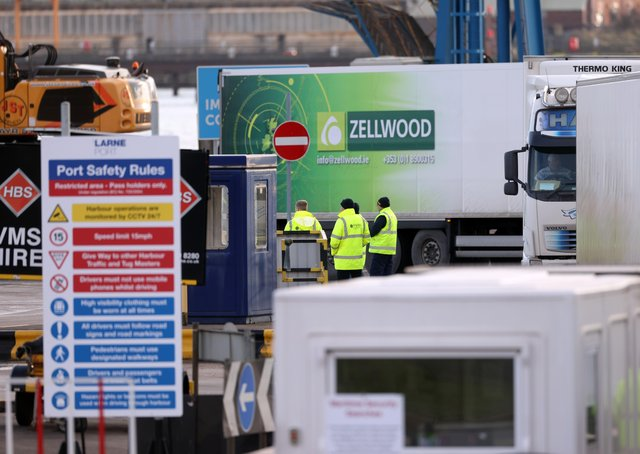 Workers based in the Port of Larne examine vehicles during February, in the aftermath of Brexit and the NI Protocol