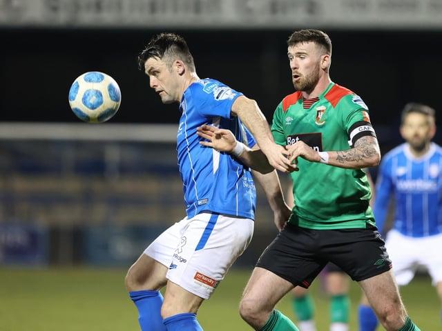 Eoin Bradley holds off Patrick McClean