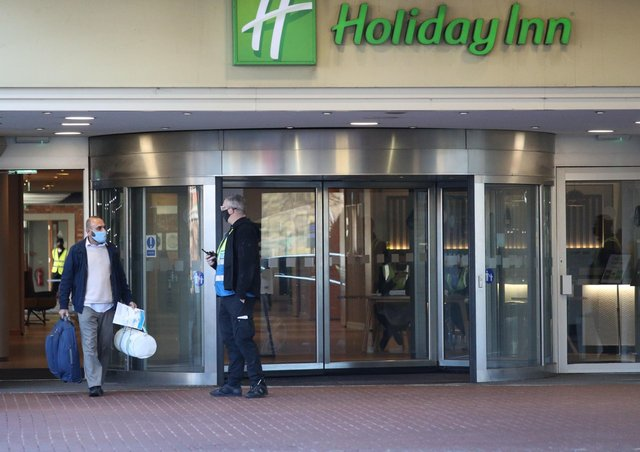 A guest leaves the Holiday Inn hotel near Heathrow Airport, London, after completing their 10-day stay at the government-designated quarantine hotel. There will now be a hotel quarantine in Northern Ireland for arrivals from red list countries. Photo:  Jonathan Brady/PA Wire