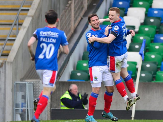 Linfield's Mark Haughey pictured after scoring his team's opener against Ballymena United
