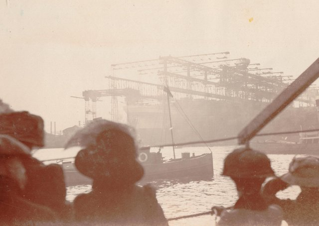 A sepia photo of the RMS Olympia launch