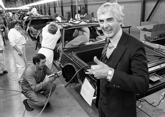 John DeLorean on the production line of his Dunmurry factory in October 1981. Pacemaker Press Intl