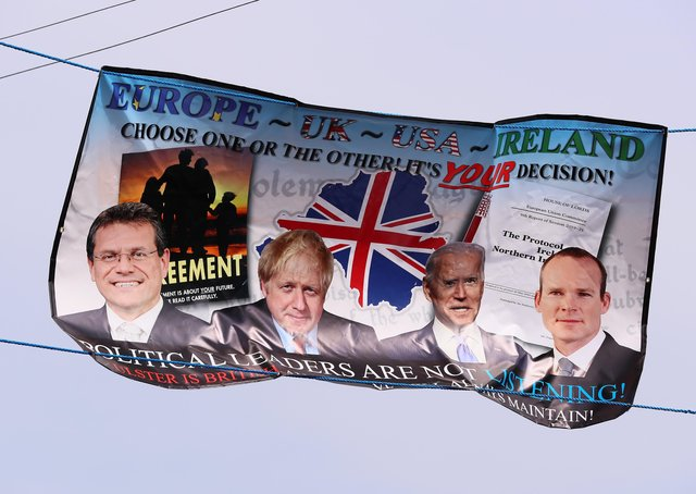 Anti Northern Ireland Protocol and Irish Sea border posters appear in different locations around Belfast.  There has been ongoing protest by Loyalists one the changes which were introduced following BREXIT at the start of the year. A poster pictured on Dee Street, beside the a Titanic mural, in east Belfast. Picture by Jonathan Porter/PressEye
