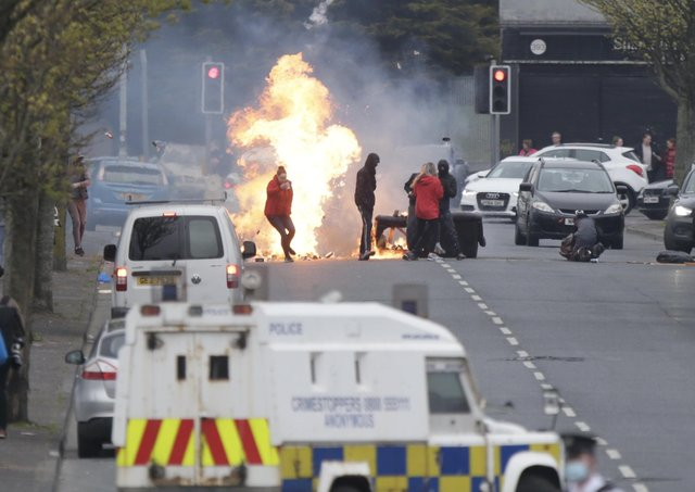 Loyalist rioters burn a barricade on Lanark Way, Belfast on Monday night before they attacked police with missiles.