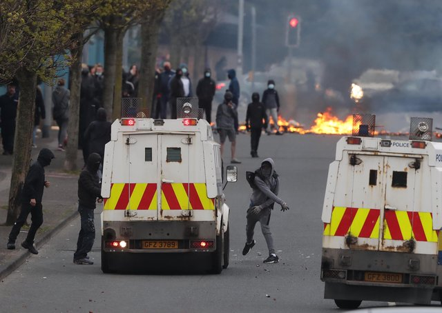 PSNI vehicles and loyalist protesters during further unrest on Lanark Way in Belfast. Picture date: MondayApril 19, 2021.
