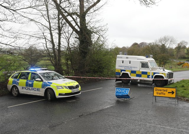 PSNI vehicles block a road during a security operation which has been ongoing since Monday on the Ballyquin Road , close to Dungiven, pIC: Niall Carson/PA Wire