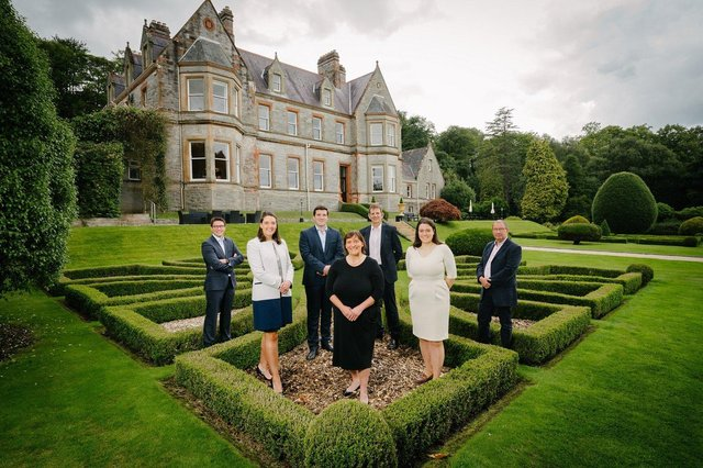 Pictured celebrating the opening of the luxury, private-hire venue, Magheramorne Estate are Ryan Walker, Magell Limited, Katherine Allen, James Allen, Jane Allen, David Allen, Sara Allen and John Walker (Junior), Magell Limited
