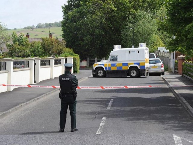 A PSNI officer pictured at the scene in Eglinton on June 18, 2015.