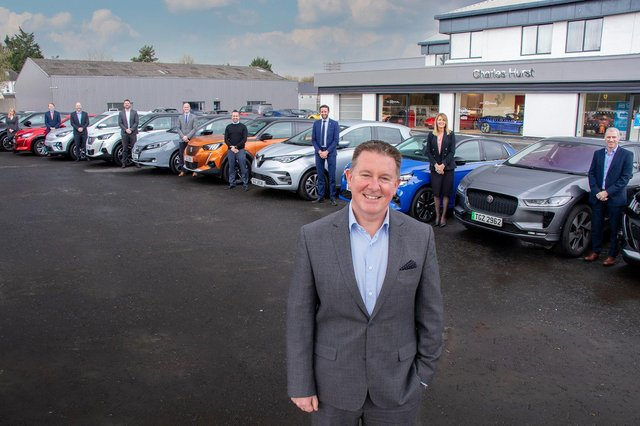 Charles Hurst Group Operations Director, Jeff McCartney and Charles Hurst employees with their fully electric company cars