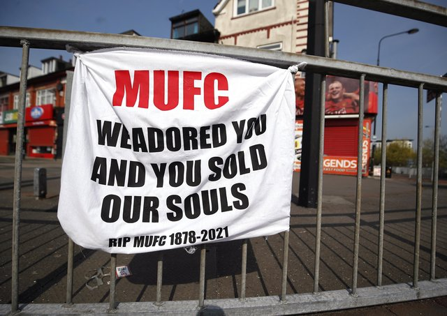 File picture of a banner left by Manchester United fans objecting to the clubs decision to join the European Super League at Sir Matt Busby Way, Manchester.