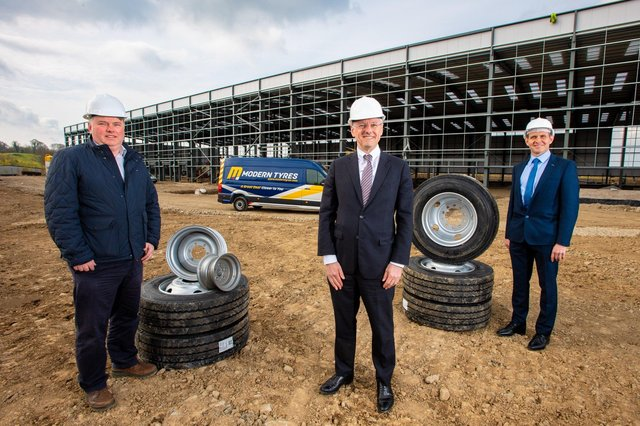 Rory Byrne, Director of Modern Tyres with Kevin Holland, CEO, Invest NI and James McKee, Financial Director, Modern Tyres