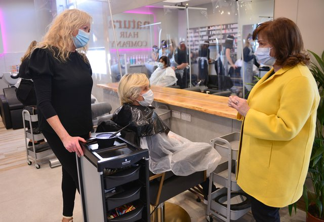 Economy Minister Diane Dodds in Lisburn with salon owner Martine Broggy at the reopening of Natural Hair Company