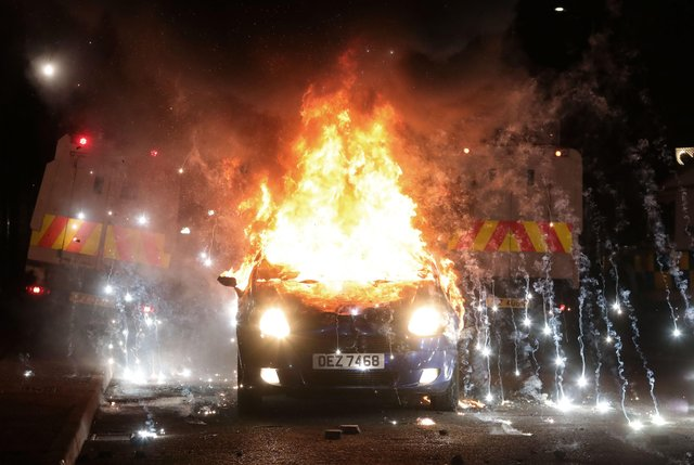 A vehicle burns during disturbances in the Tiger's Bay area of north Belfast earlier this month