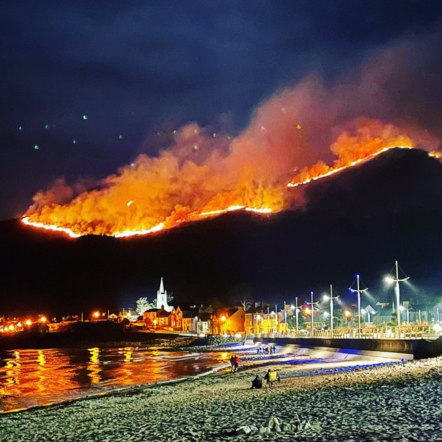 The huge gorse fire spreading across the Mourne Mountains in Co Down, as seen from Newcastle.