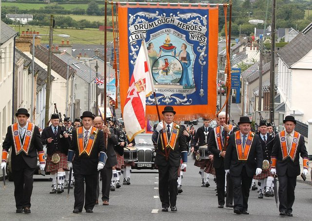 Rathfriland No 3 District officers accompanied by the Master and Deputy Master of Drumlough Heroes LOL No 153 lead the 12th morning parade in Rathfriland in 2005. Picture: News Letter archives