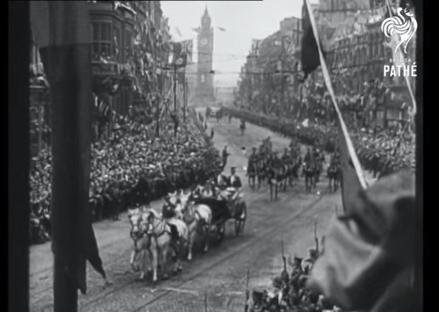 The royal procession as it rides from the docks past the Albert Clock through cheering crowds towards Belfast City Hall in June 1921. From Pathé film reel