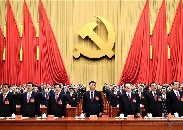 Image (from PA) of Xi Jinping - the Chinese leader (centre) - at a communist party gathering