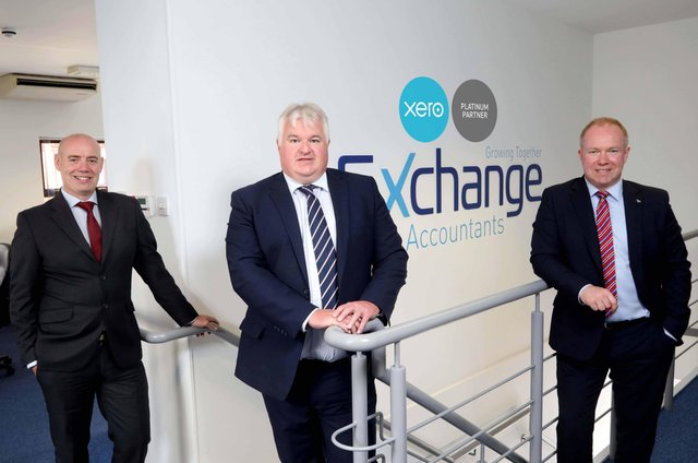 Exchange Accountants directors Conor Walls, William Gould and Gary Laverty proudly display the Xero Platinum badge on the office wall after the digital accountancy specialist achieved Platinum Partner status with market-leading cloud accountancy software provider Xero