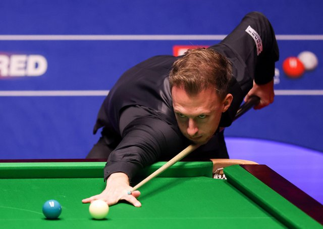 Judd Trump plays a shot during the Betfred World Snooker Championships 2021 at The Crucible, Sheffield.