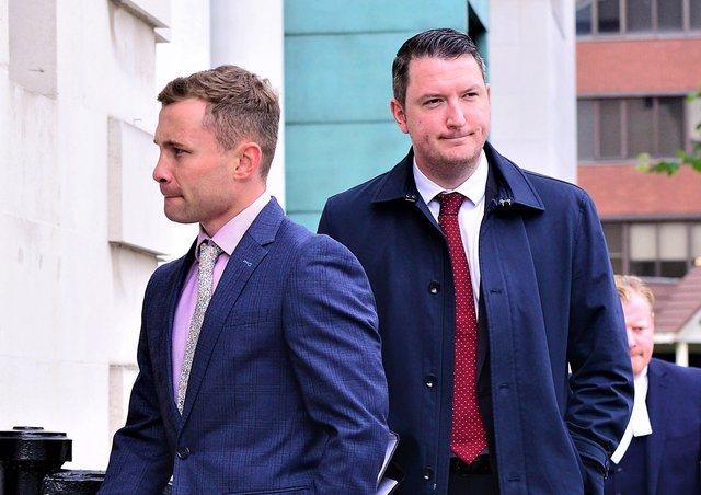 Boxer Carl Frampton (left) entering court as part of a financial lawsuit last year, with his lawyer John Finucane walking close behind