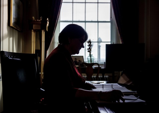 Arlene Foster at work in her Stormont office last month. She will quit as DUP leader on May 28. Photo: Liam McBurney/PA Wire