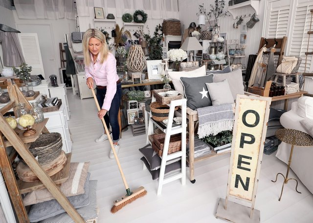 Leah Matthews at The White Lighthouse Interiors and Furniture in east Belfast prepares to reopen today
