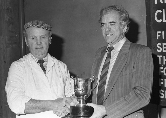 Ulster Farmers' Union president John Warden presents the DANI Cup to Bertie Kerr of Ballymoney, exhibitor of the best performance-tested boar at the show and sale of pedigree pigs which was held at Balmoral in March 1991. Picture: Farming Life archives