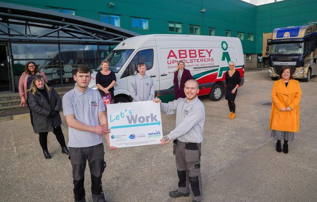 Host employer Abbey Upholsterers with participants and representatives from the Let's Work project board