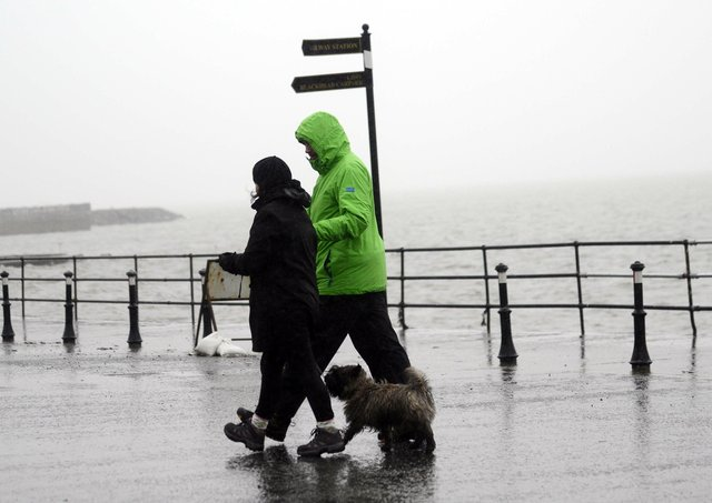 Wet Weather at Whitehead  in Co Antrim. Pic Colm Lenaghan/Pacemaker