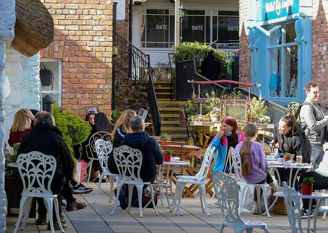 People relax in the Craft Village in Londonderry as outdoor hospitality reopened on April 30. Photo: George Sweeney.  DER2117GS  045