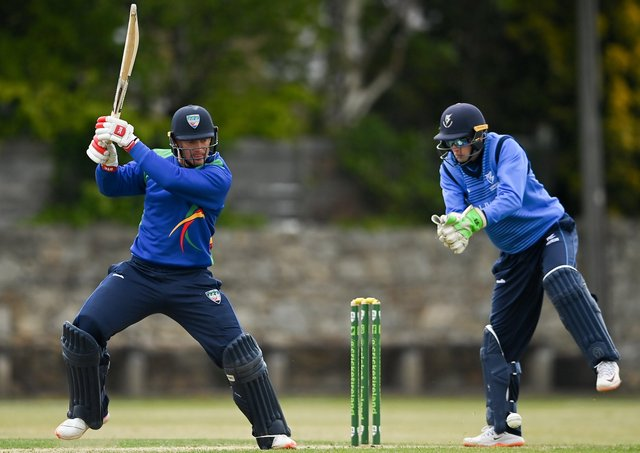 Graham Hume of North West Warriors playes a shot past Leinster Lightning wicketkeeper Lorcan Tucker during the Inter-Provincial Cup 2021 match between Leinster Lightning and North West Warriors at Pembroke Cricket Club in Dublin. Photo by Brendan Moran/Sportsfile