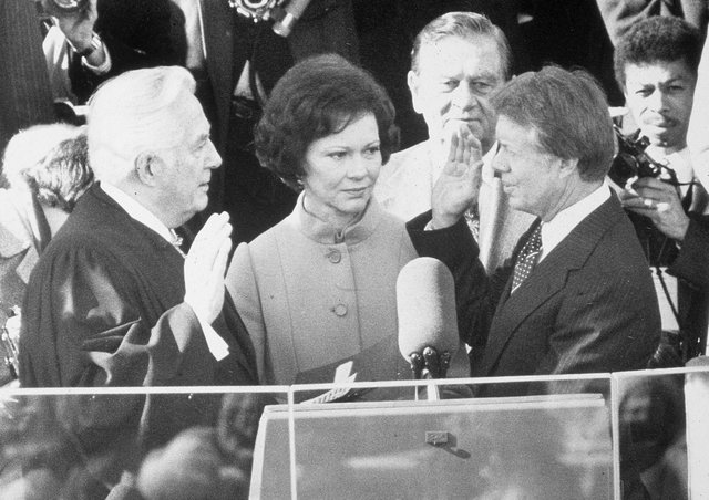 Democrat Jimmy Carter is sworn in by chief justice Earl Burger as the 39th president of the United States while first lady Rosalynn looks on, Washington DC, January 20, 1977. Picture: Hulton Archive/Getty Images