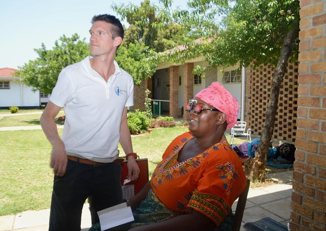 Andrew Spence with a patient in Zimbabwe