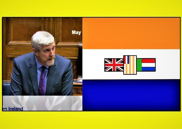 John O'Dowd in the Assembly today and the old apartheid-era flag of South Africa