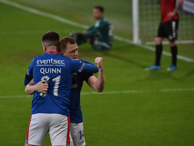 Shayne Lavery celebrates his goal with Niall Quinn