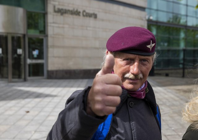 A man wearing the beret of the British Parachute Regiment gives a thumbs up outside Laganside Court in Belfast after the case against two veterans who were accused of the murder of Joe McCann 1972 collapsed. Photo: Liam McBurney/PA Wire