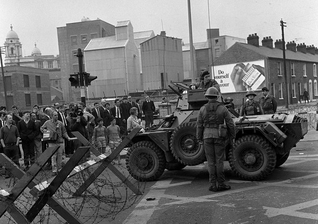 A military armoured car and barbed wire road block in Divis Street, Belfast.