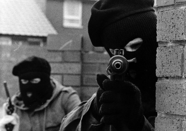 IRA terrorists pictured on the Whiterock Road in Belfast during the Troubles