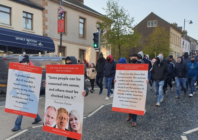Placards citing Thomas Paine gathers at a rally against the Irish Sea customs border in Markethill on May 5, 2021.