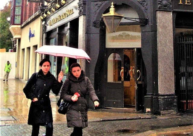 Generic image of women outside a pub on a rainy day, by artist It's No Game, from: https://search.creativecommons.org/photos/9c76aca9-2bc9-4eb3-b351-e12dc0418c6c