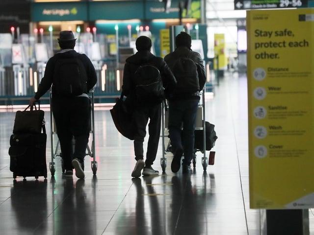 Passengers make their way through Dublin Airport. (Photo: PA)