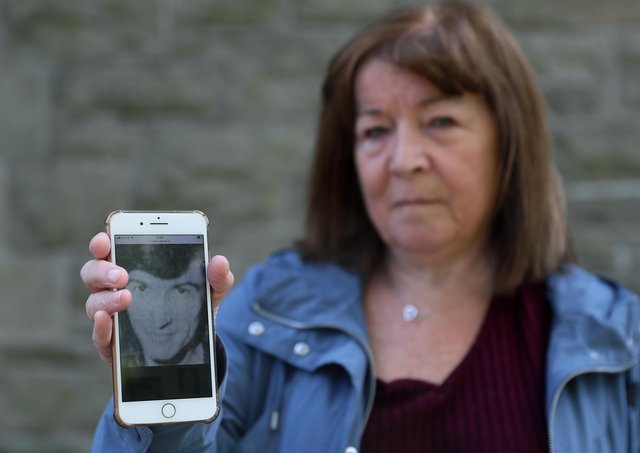 Margaret Valente, displays an image of her husband Peter who was killed by the IRA in Belfast in 1980, at the WAVE Trauma Centre in Belfast. PA image