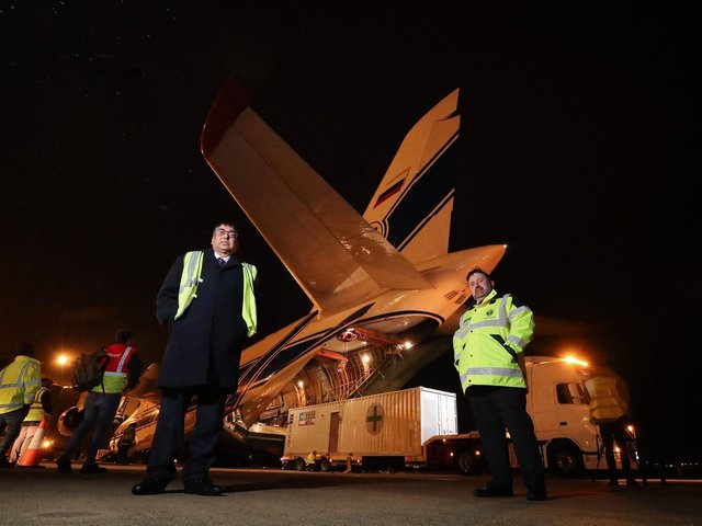 Health Minister Robin Swann (right) and Deputy Chief Medical Officer Naresh Chada at Belfast Airport as the world's largest cargo plane leaves Northern Ireland with three 18-tonne oxygen generators and 1,000 ventilators as part of the UK's latest response to India's Covid-19 crisis.